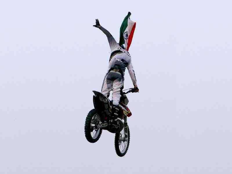 One of the RedBull X-Fighters performs at the India Gate in New Delhi. (PTI Photo/Shahbaz Khan)