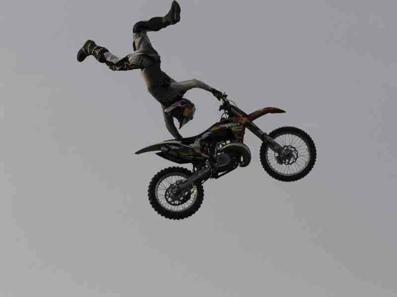 Motor bikers are doing stunts during Red Bull X-Fighters Freestyle Motocross (FMX) motorbike stunt competition, in New Delhi, India. (Hindustan Times Photo/Virendra Singh Gosain)