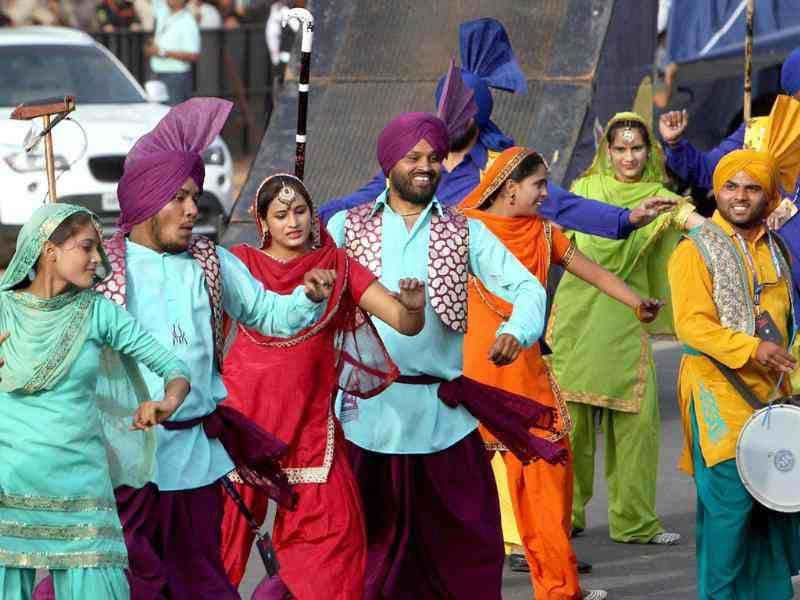 Punjabi folk artists perform during the RedBull X-Fighters event at India Gate in New Delhi.(PTI Photo/Shahbaz Khan)