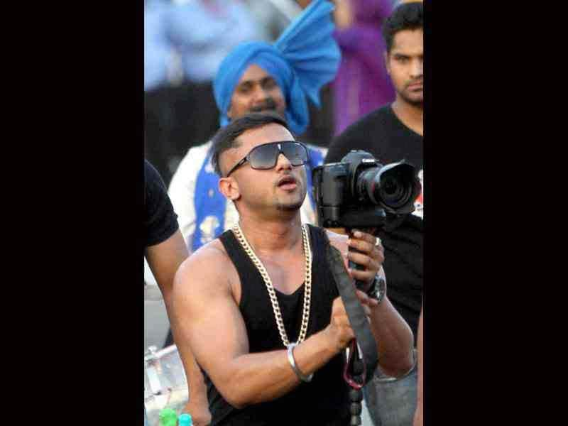 Punjabi rapper, Yo Yo Honey Singh, holding carema, performs during the RedBull X-Fighters event at India Gate in New Delhi. (PTI Photo/Shahbaz Khan)