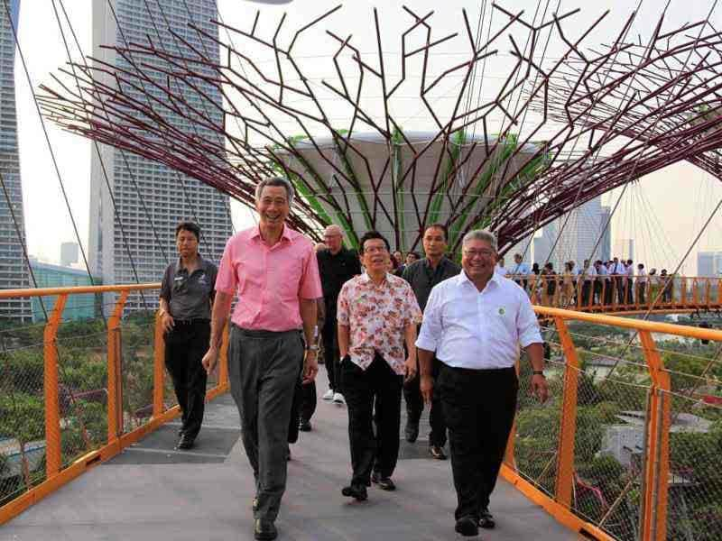 Singapore's Prime Minister Lee Hsien Loong, second left, walks among the Supertrees with the Marina Bay Sands in the background. AP/Wong Maye-E