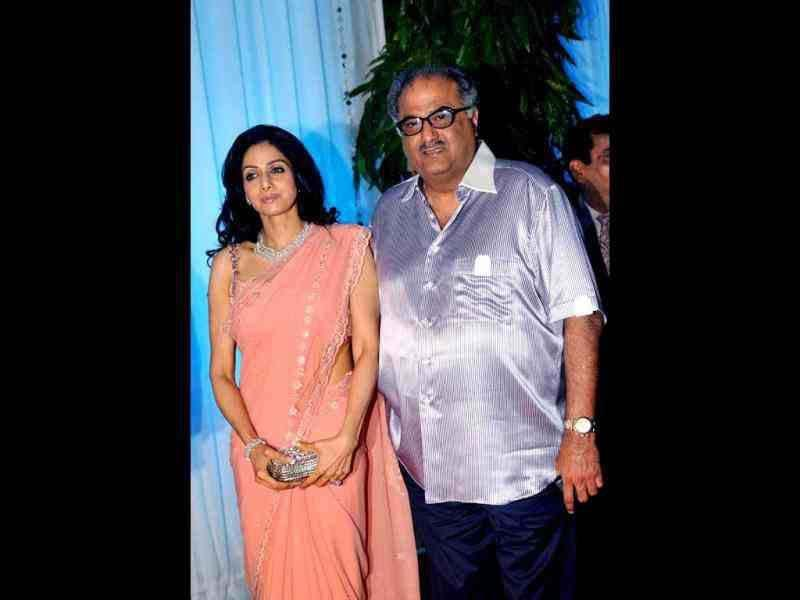 Sridevi looked stunning in a peach sari as she arrived at the reception with husband Boney Kapoor.