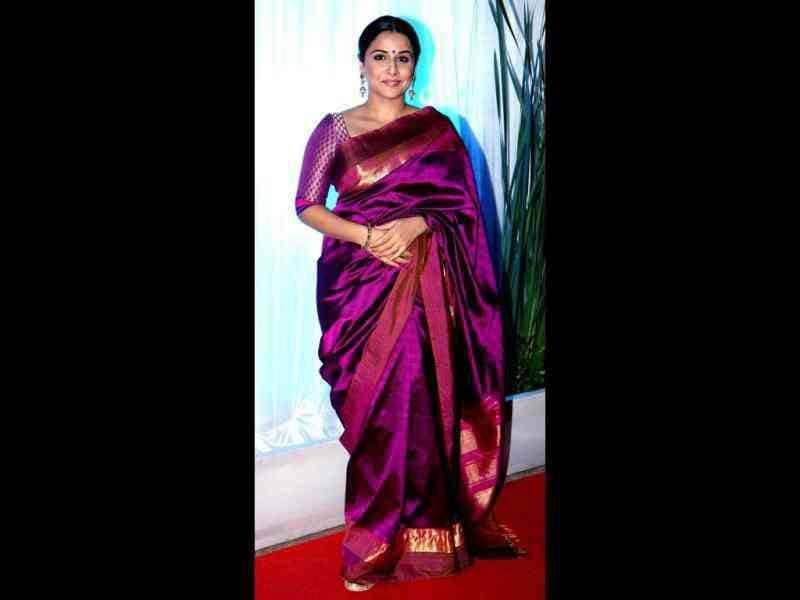 Vidya Balan wore a pretty purple sari at the reception.