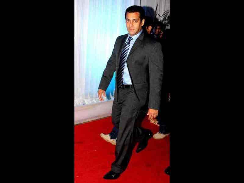 Salman Khan looked dapper in a black suit as he arrived at the reception.