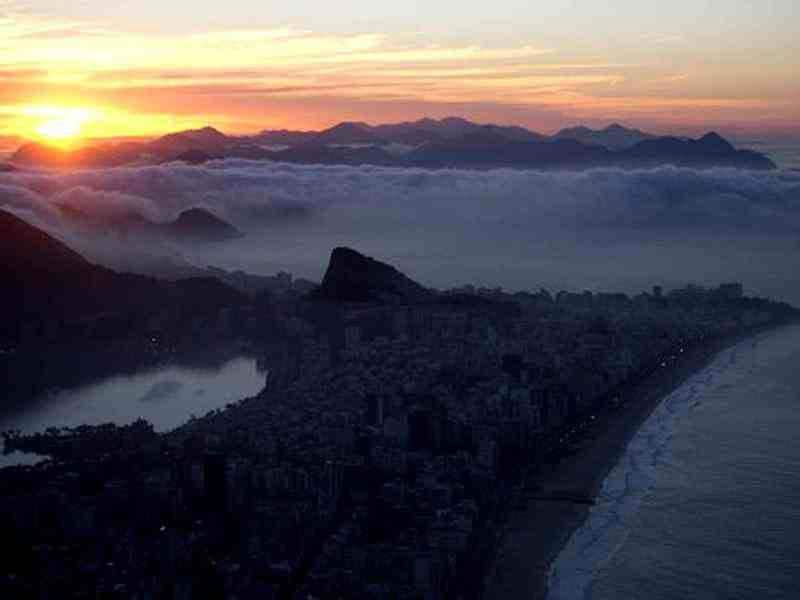 General view of Rio de Janeiro, Brazil at sunrise. AFP Photo / Christophe Simon