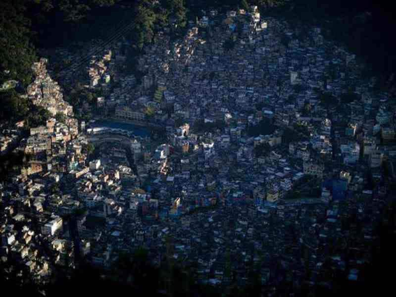 Upper view of the Rocinha shanty town at sunrise in Rio de Janeiro. AFP Photo / Christophe Simon
