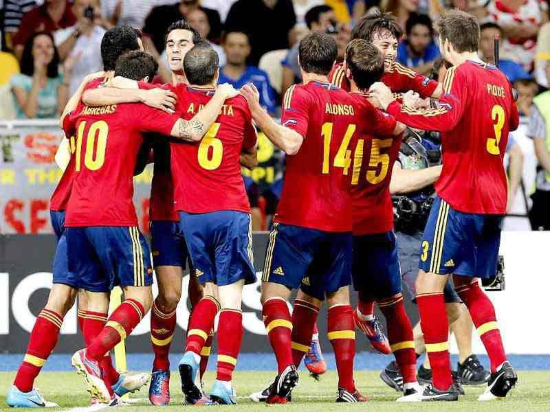 Spain's players celebrate their team's goal during the Euro 2012 soccer championship final between Spain and Italy in Kiev, Ukraine. (AP Photo/Antonio Calanni)