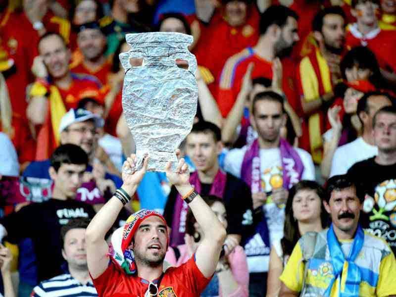A Spanish fan cheers before the Euro 2012 football championships final match Spain vs Italy on July 1, 2012 at the Olympic Stadium in Kiev. (AFP Photo/Damien Meyer)