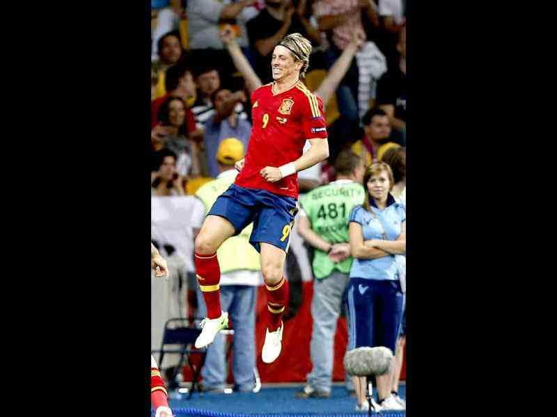 Spain's Fernando Torres celebrates after scoring his side's third goal during the Euro 2012 soccer championship final between Spain and Italy in Kiev, Ukraine, Sunday, July 1, 2012. (AP Photo/Jon Super)
