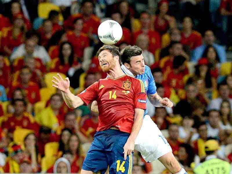 Spanish midfielder Xabi Alonso (L) vies with Italian defender Andrea Barzagli during the Euro 2012 football championships final match Spain vs Italy at the Olympic Stadium in Kiev. AFP PHOTO / PATRICK HERTZOG