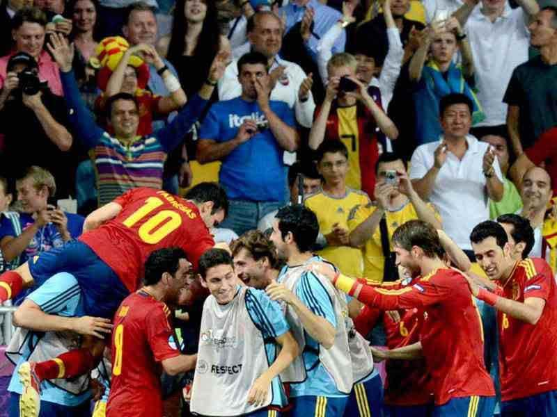 Spanish players celebrate during the Euro 2012 football championships final match Spain vs Italy at the Olympic Stadium in Kiev. AFP PHOTO/PATRICK HERTZOG
