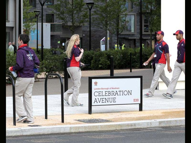 LOCOG employees cross Celebration Avenue in the Olympic Village built for the London 2012 Olympic Games in Stratford, east London. The village will accomodate up to 16,000 athletes and officials from more than 200 nations. Reuters/Olivia Harris