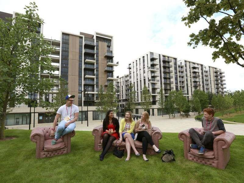 Students who were asked to test facilities for the night sit in Victory Park in the Olympic Village built for the London 2012 Olympic Games in Stratford, east London The village will accomodate up to 16,000 athletes and officials from more than 200 nations. Reuters/Olivia Harris