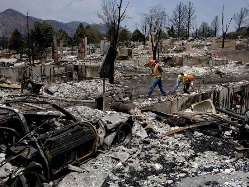 Utility workers search for gas leaks in the Mountain Shadows subdivision after the community was ravaged by the Waldo Canyon fire in Colorado Springs, Colorado. REUTERS/Adrees Latif