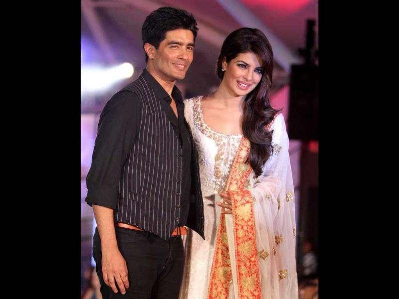 Priyanka Chopra with designer Manish Malhotra on the ramp during Caring with Style seventh annual fashion show. (UNI photo)