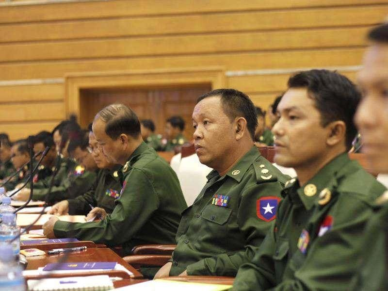 Members of parliament representing the military attend the opening of the Lower House session in Naypyitaw. Reuters/Soe Zeya Tun
