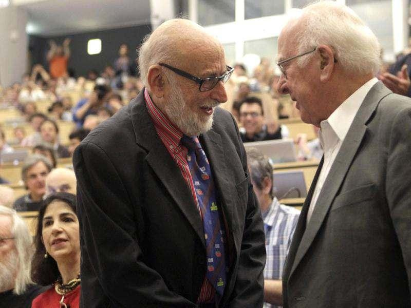 British physicist Peter Higgs (R) shakes hands with Belgium physicist Francois Englert before a scientific seminar to deliver the latest update in the search for the Higgs boson at CERN in Meyrin near Geneva. Reuters photo/Denis Balibouse