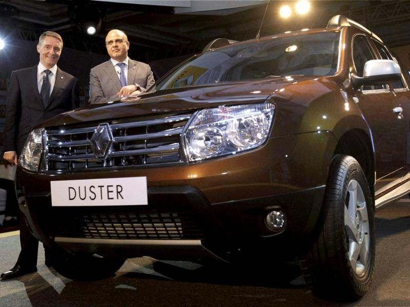 Managing director Renault India Marc Nassif and Vice President sales and Marketing Renault India Len Curran pose in front of a Renault Duster SUV diesel car at a launch function in New Delhi. PTI/Aman Sharma