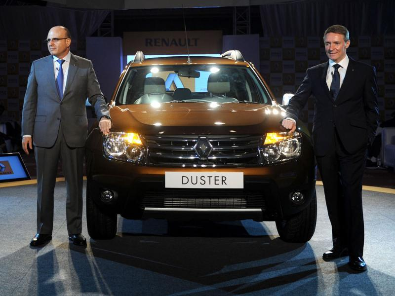 Managing director Renault India Marc Naseef and Vice President sales and Marketing Renault India Len Curran pose in front of a Renault Duster SUV diesel car at a launch function in New Delhi. AFP/Sajjad Hussain