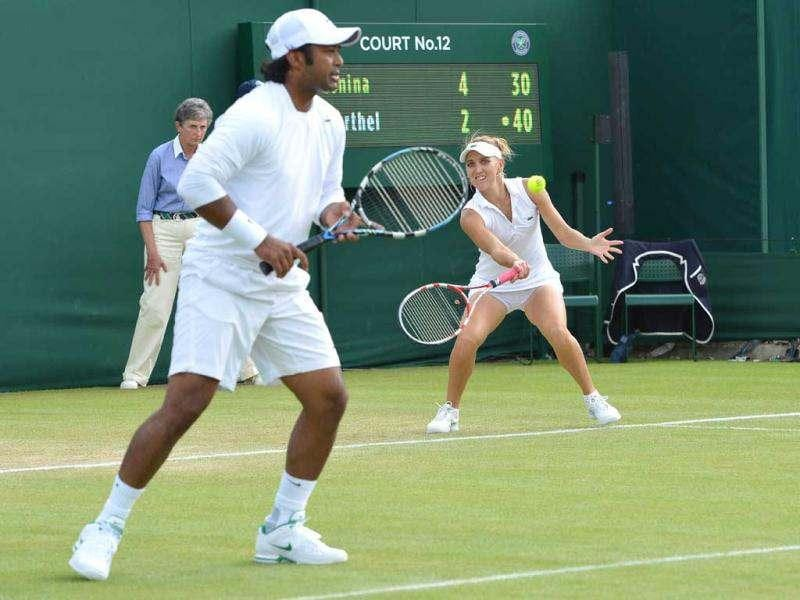 Leander Paes and Elena Vesnina during their second round mixed doubles match against Australia's Ashley Fisher and Germany's Mona Barthel on day nine of the 2012 Wimbledon Championships tennis tournament at the All England Tennis Club in Wimbledon, southwest London. AFP/Miguel Medina