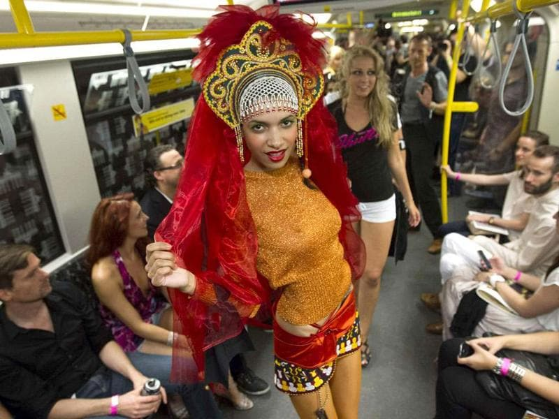 A model presents a creation during the 'Underground Catwalk' fashion show in a U-Bahn subway train in Berlin. As the Berlin Fashion Week has pitched up its tent near the Siegessaeule victory column, 17 designers sent their models on Wednesday down a catwalk that was the aisle of a crowded U-Bahn subway train terminating at a rock music club. REUTERS/Thomas Peter
