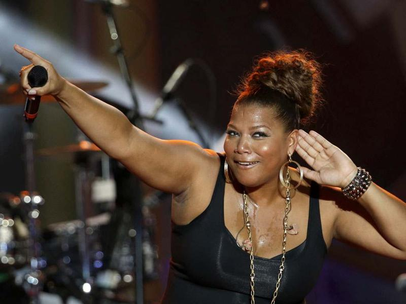 Queen Latifah performs with The Roots during an Independence Day celebration in Philadelphia. AP Photo/Matt Rourke