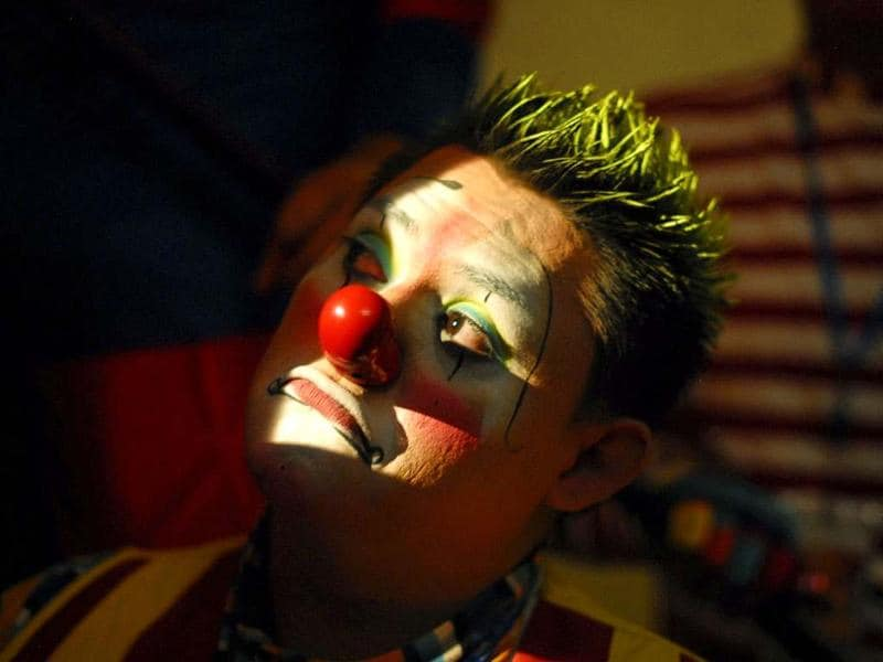 A clown participates in an international clown festival in San Salvador July 4, 2012. Every year clowns from Mexico, Colombia and the U. meet in San Salvador to exchange make-up tips and the latest tricks and jokes. REUTERS/Ulises Rodriguez