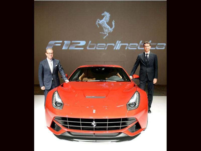 Ferrari S.p.A product marketing manager Andrea Bassi (R) and Ferrari Japan president and CEO, Herbert Appleroth (L), pose with the company's latest Ferrari F12 Berlinetta during its Japan premier in Tokyo. AFP Photo/Toshifumi Kitamura