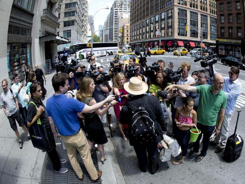 Paparazzi crowds around the Batman Begins star as she leaves a TV studio on Times Square in New York.