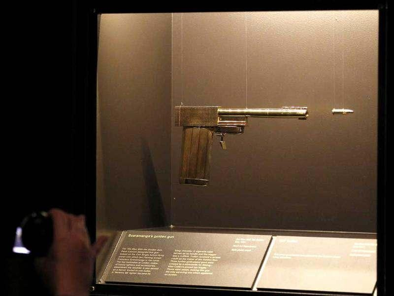 The gun used in the James Bond film 'The Man with the Golden Gun' is pictured during a press preview for an exhibition entitled 'Designing 007 - Fifty Years of Bond Style' at the Barbican in central London. The exhibition celebrates the 50th anniversary of the James Bond franchise. AFP PHOTO / CARL COURT