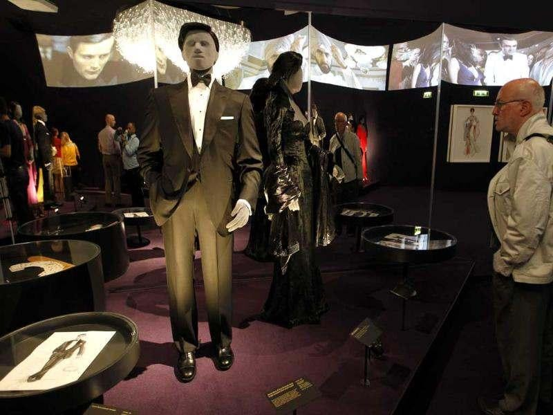 A visitor looks at a tuxedo worn by James Bond actor, Pierce Brosnan, in the film 'GoldenEye' on display in the exhibition 'Designing 007 - Fifty Years of Bond Style' at the Barbican centre in London. (AP Photo/Sang Tan)