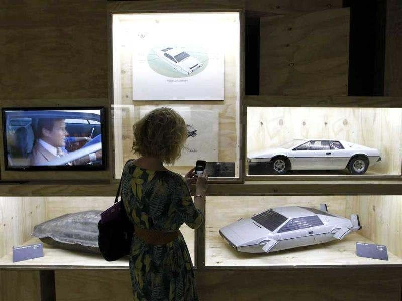 A visitor takes picture of models of James Bond's Lotus Esprit used in the film 'The Spy Who Loved Me' on display in the exhibition 'Designing 007 - Fifty Years of Bond Style' at the Barbican centre in London. (AP Photo/Sang Tan)