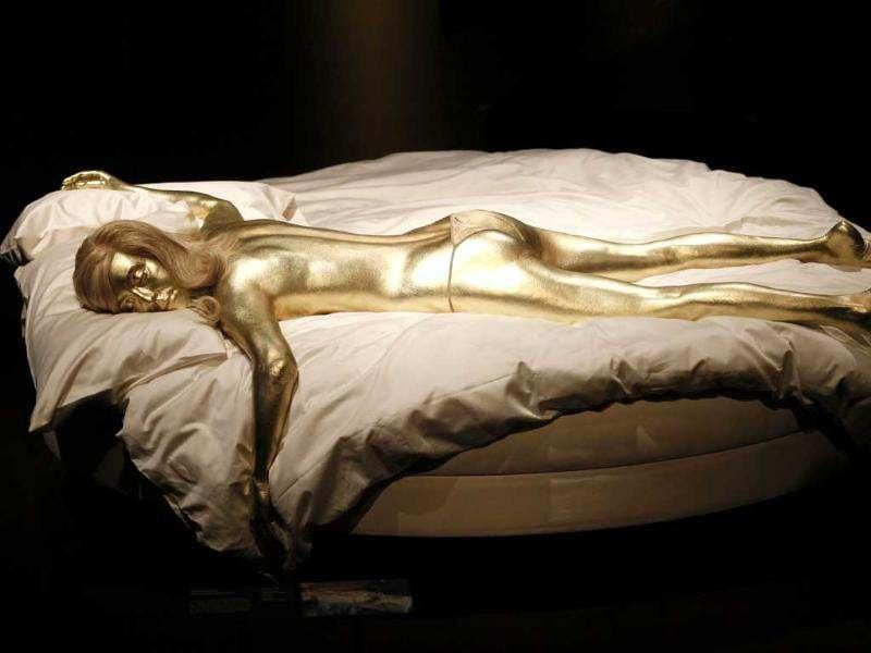 A recreation of Jill Masterson's golden body in the film 'Goldfinger' is seen on display in the exhibition 'Designing 007 - Fifty Years of Bond Style' at the Barbican centre in London. (AP Photo/Sang Tan)