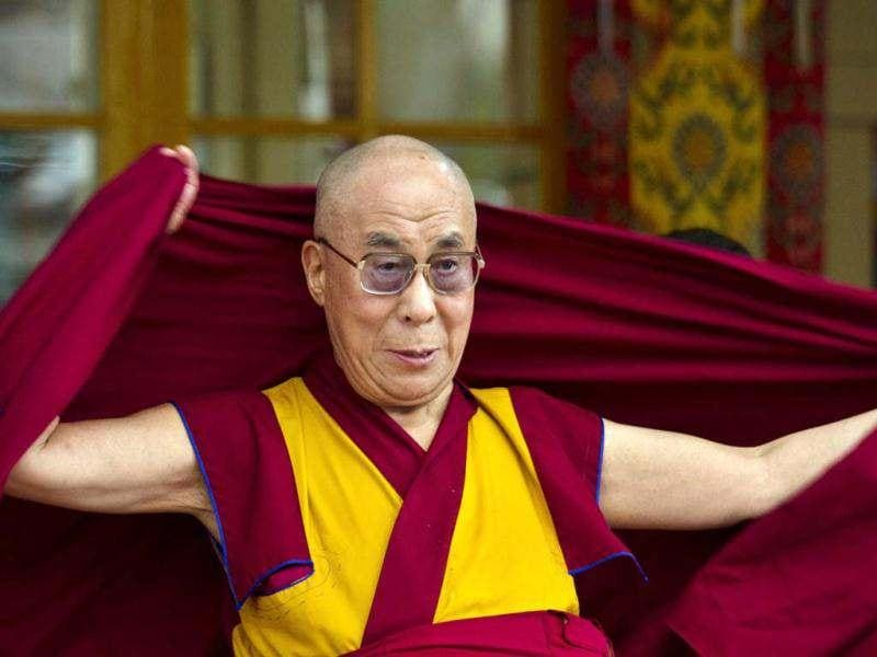 Tibetan spiritual leader the Dalai Lama adjusts his robe at the Tsuglakhang temple in Dharmsala. The Dalai Lama celebrates his 77th birthday today with festivities held for the entire day at Tsuglakhang complex. (AP Photo)
