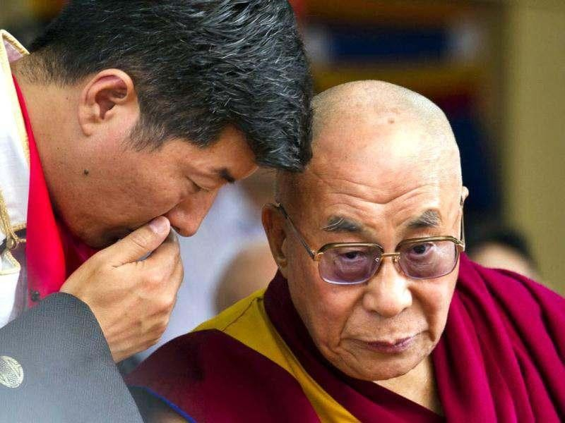 Tibetan spiritual leader the Dalai Lama, right, listens to Lobsang Sangay, Prime Minister of Tibet's government in exile, during a function at the Tsuglakhang temple in Dharmsala, India. The Dalai Lama celebrates his 77th birthday today with festivities held for the entire day at Tsuglakhang complex. (AP Photo)