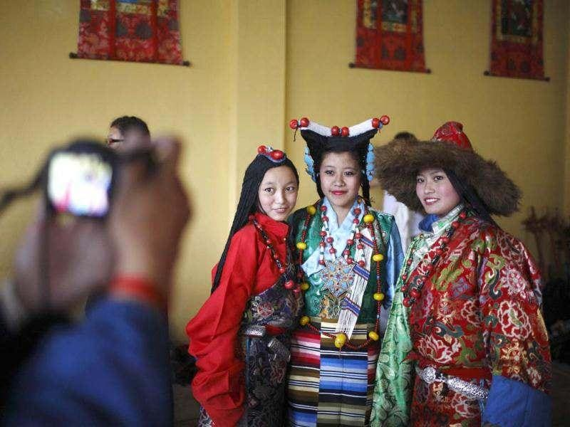 Tibetans girls dressed in traditional attire pose for a picture while celebrating the 77th birthday of their exiled spiritual leader the Dalai Lama in Kathmandu. (Reuters)