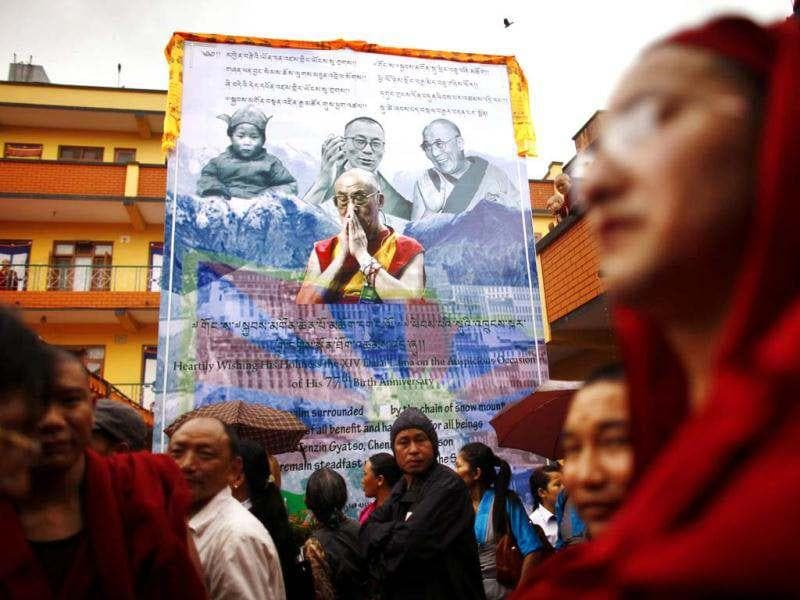 Tibetans gather to mark the birthday of their spiritual leader the Dalai Lama at a monastery in Katmandu, Nepal. Festivities are held to mark the 77th birthday of the Dalai Lama, who lives in Dharmsala. (AP Photo)