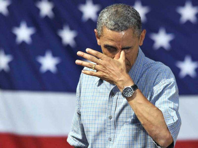 President Barack Obama wipes sweat from his eye after a speech at Washington Park in Sandusky, Ohio, Thursday, July 5, 2012. Obama is on a two-day bus trip through Ohio and Pennsylvania. AP Photo/David Richard