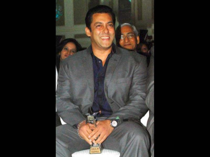 Salman Khan is having a light moment during the award ceremony.