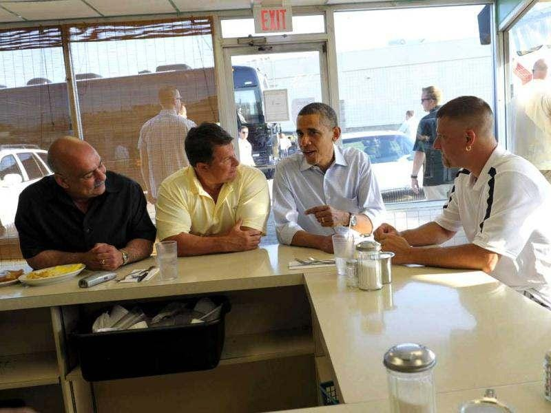 President Barack Obama talks with patrons of Ann's Place in Akron, Ohio. AP Photo/Susan Walsh