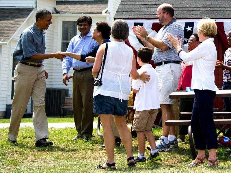 US President Barack Obama (L) shakes hands during a campaign event at Wolcott House Museum complex in Maumee, Ohio, July 5, 2012, while on a bus tour of Ohio and Pennslyvania. AFP Photo/Jim Watson