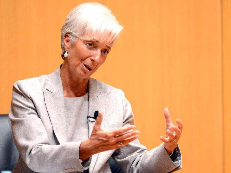 International Monetary Fund (IMF) chief Christine Lagarde gestures while answering a student's question at the Mita University campus in Tokyo. Lagarde warned that the global economy was slowing, with a soon-to-be published growth outlook lower than earlier forecasts. (AFP Photo / Toshifumi Kitamura)