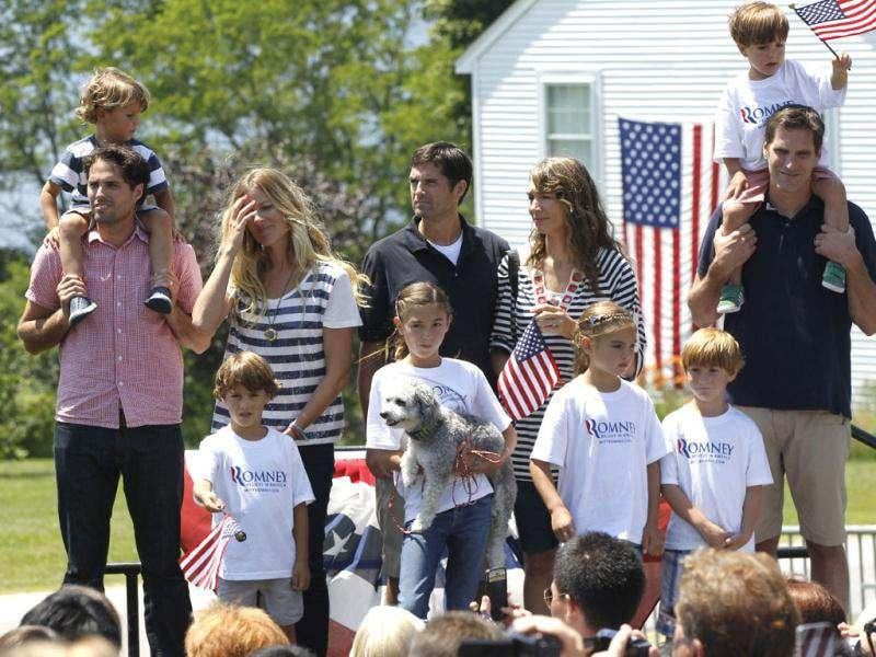 Craig Romney, left, Matt Romney, center, and Josh Romney, right, sons of Republican presidential candidate Mitt Romney, stand with other family members at Brewster Academy during a rally at the end of the Fourth of July Parade in Wolfeboro, N.H. (AP Photo/Charles Dharapak)