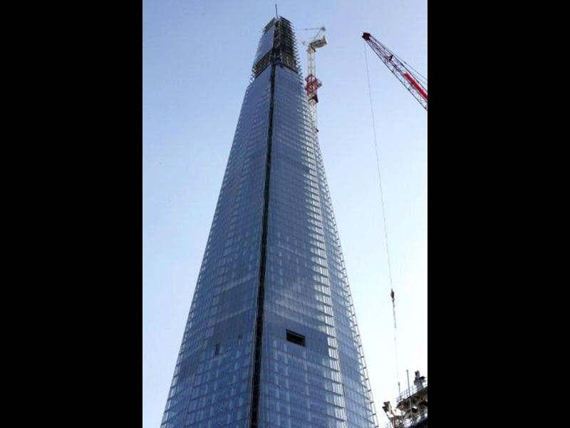 A picture shows the Shard under construction in central London. AFP Photo / Miguel Medina