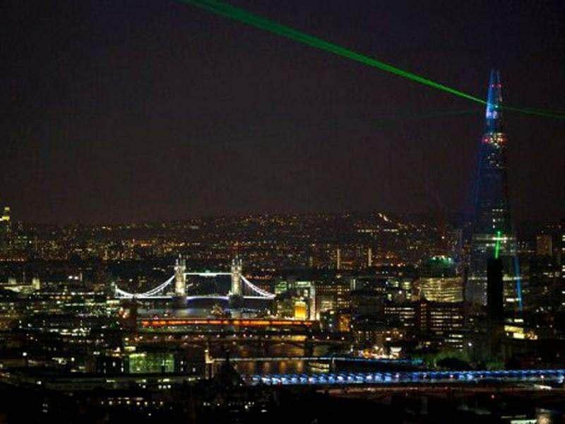 Lasers light up the night sky from the Shard building during its inauguration in central London. Europe's tallest skyscraper the Shard was inaugurated in a dazzling sound and light show befitting its status as the capital's brashest and most controversial building. The Shard's inauguration marks the completion of the exterior of the building, located on the south bank of the River Thames at London Bridge, while work on the inside is expected to continue into 2013. AFP Photo/Andrew Cowie