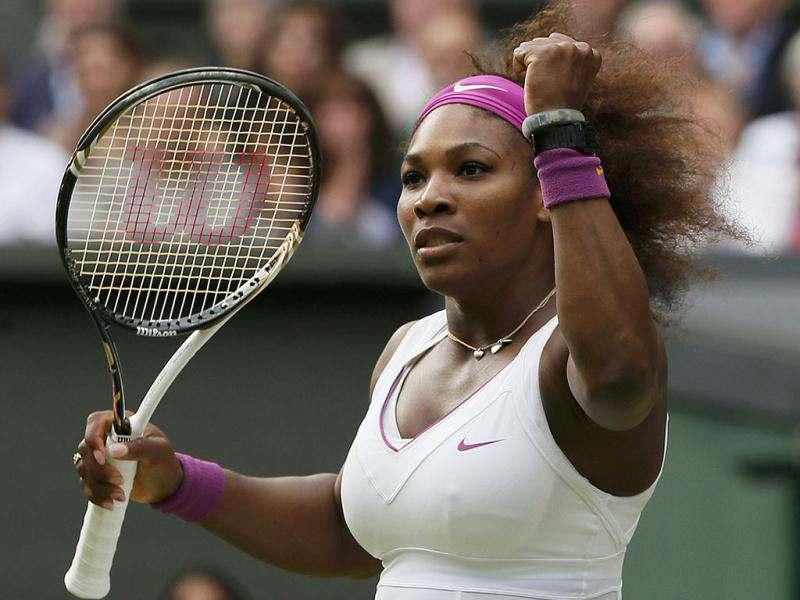 Serena Williams of the US reacts to breaking the serve of Agnieszka Radwanska of Poland in the third set during their women's final tennis match at the Wimbledon tennis championships in London. Reuters/Stefan Wermuth