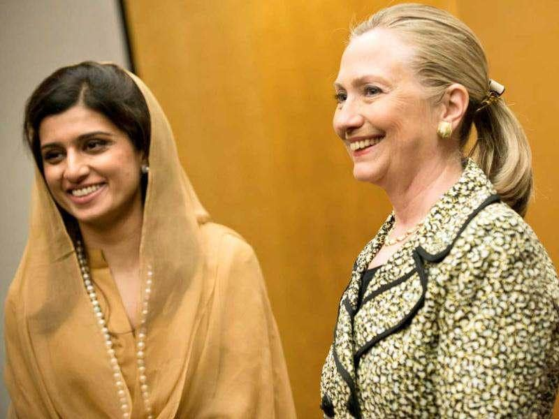US Secretary of State Hillary Clinton (R) and Pakistan's foreign minister Hina Rabbani Khar (L) pose before the start of their bilateral meeting at the Prince Park Tower Hotel Center in Tokyo on the sidelines of the Tokyo Conference on Afghanistan. The world conference aimed at charting a course for Afghanistan once foreign combat forces leave in 2014 got under way in Tokyo. AFP Photo / Brendan Smialowski
