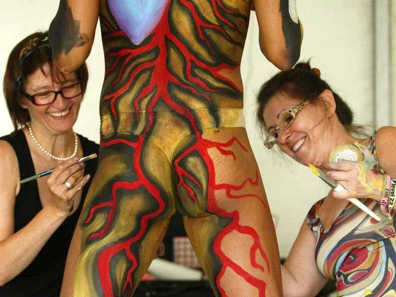 Artists paint a model during the annual World Bodypainting Festival in Poertschach. Reuters/Heinz-Peter Bader