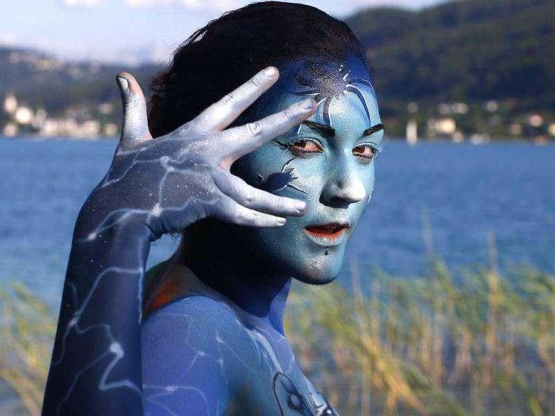 A participant poses with her body paintings during the 15th World Bodypainting Festival in front of the Woerthersee lake in Poertschach. AFP Photo/Alexander Klein