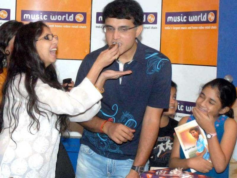 Former Indian cricket captain Sourav Ganguly being offered a piece of cake by his fan during his 40th birthday celebrations in Kolkata. PTI photo